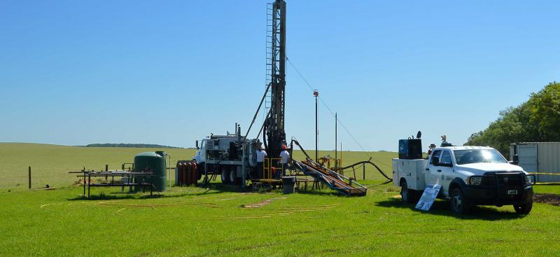 District well drilling rig and truck