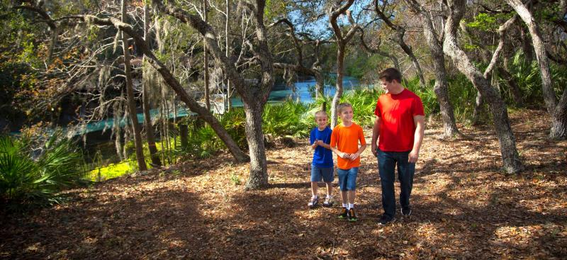 Family hiking by a Florida springs