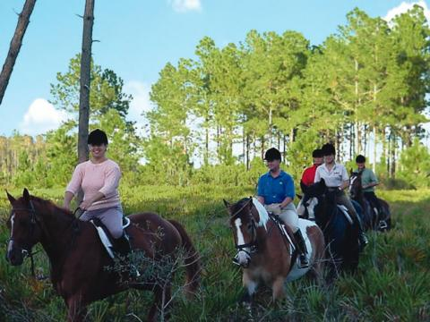 riders on horesback on District property