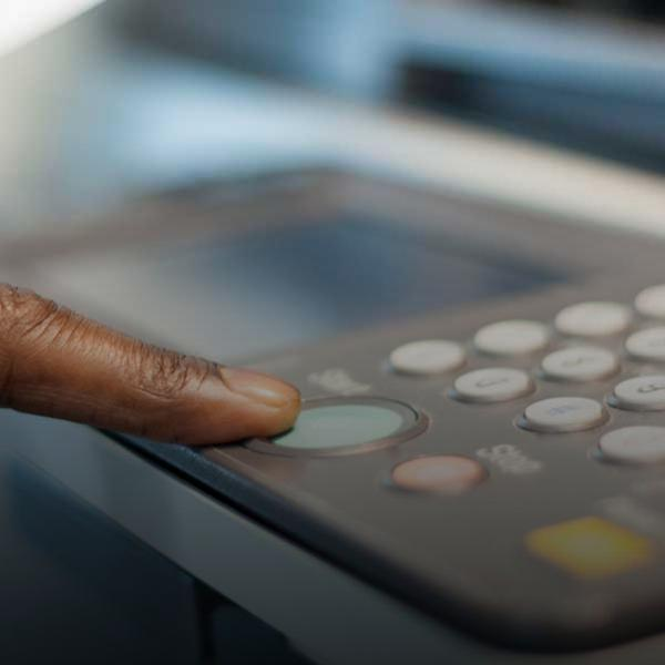 finger on fax machine keypad