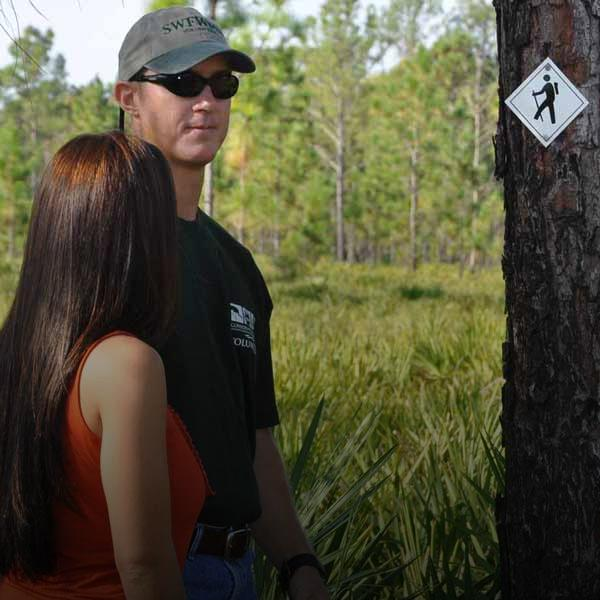 Couple hiking at Jay B. Starkey Preserve