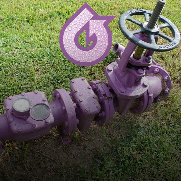 purple reclaimed pipes on grass